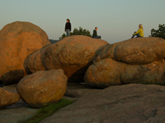 people sitting on boulders - Missouri Vacations