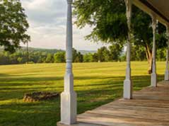 cabin porch overlooking open field - Missouri Vacations