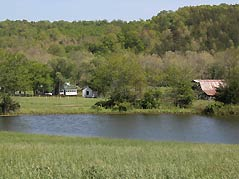 pond with barn in background - Missouri Vacations