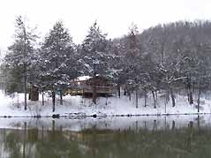 cabin in winter snow - Missouri Vacations