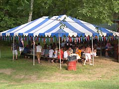 people eating under tent - Missouri Vacations