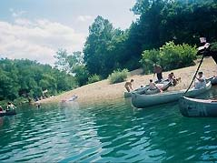 canoes on a gravel bar - Missouri Vacations