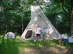 family in front of teepee campsite - Missouri Vacations