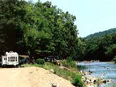 RV parked next to river - Missouri Vacations