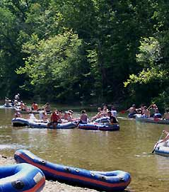 people floating in rafts - Missouri Vacations