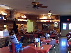 tables set in a BBQ restaurant - Missouri Vacations