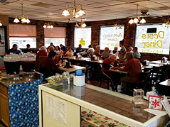 people eating at a diner - Missouri Vacations