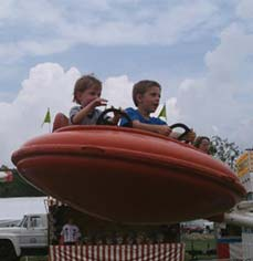 boys in a carnival ride - Missouri Vacations