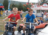 kids riding carnival ride - Missouri Vacations