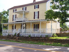 two story old yellow home - Missouri Vacations
