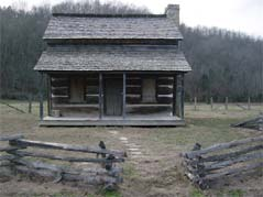 old log home with split rail fence - Missouri Vacations