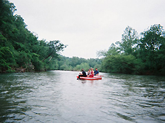 raft floating on river - Missouri Vacations