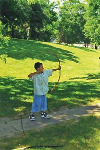 young man doing archery - Missouri Vacations