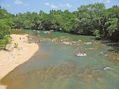 rafts floating down a river - Missouri Vacations