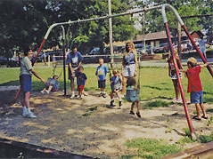 families at a swingset - Missouri Vacations