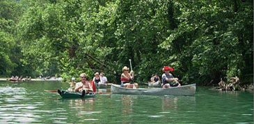 people paddling canoes - Missouri Vacations