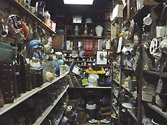 shelves with trinkets and odds and ends for sale - Missouri Vacations