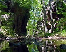 river through rock formations - Missouri Vacations